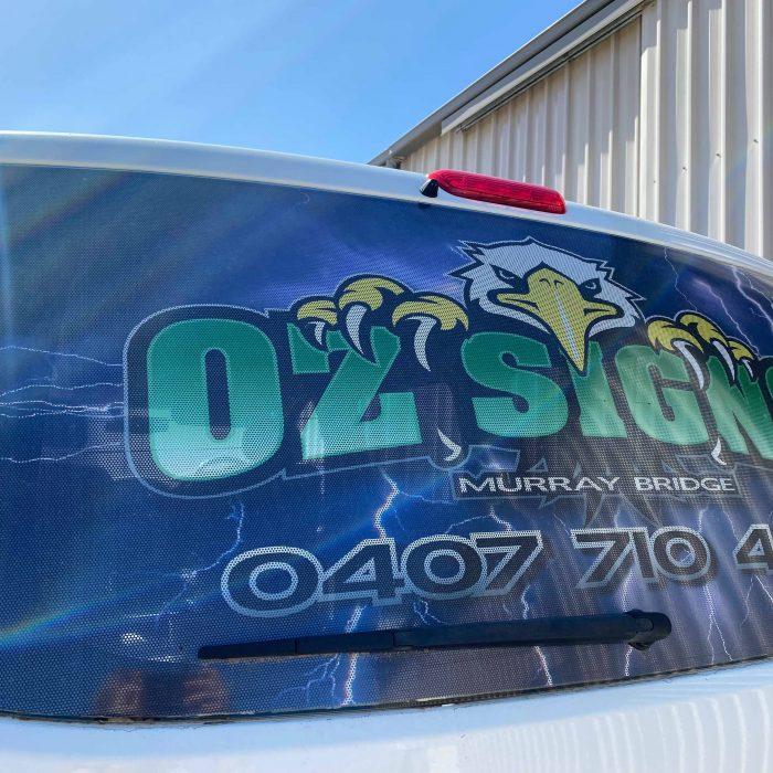 Oz Signs car window